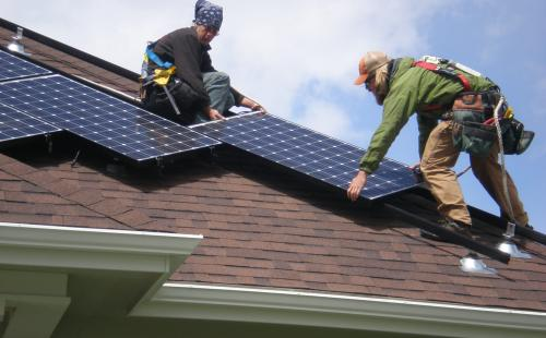 Minnesota solar workers install residential solar energy array MnSEIA policy
