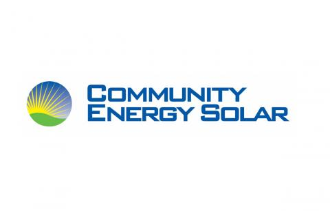 Blue Community Energy Logo with turbine, sun and green hill image