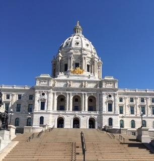 MN State Capitol Building with blue sky and steps in front