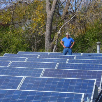 James Darabi of Solar Farm, LLC standing in a solar array